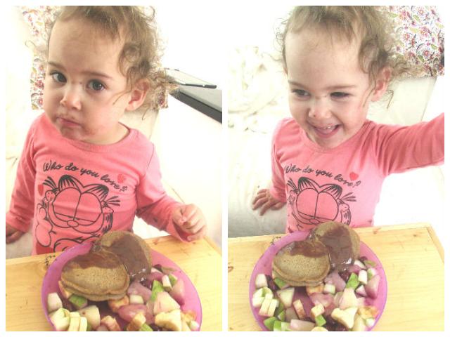 אמה אוכלת פנקייק עם ממרח חרובים וסלט פירות